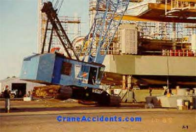 Photo of crane tipping over