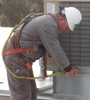 photo of worker attaching fall protection