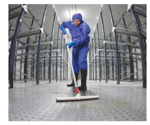 Image of worker in protective gear cleaning a floor