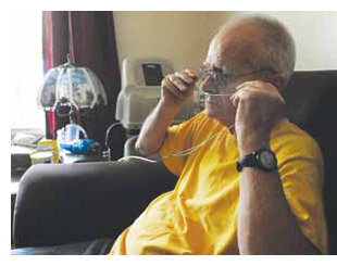 Retired coal miner Steve Day, 67, is tethered to an oxygen tank 24 hours a day.