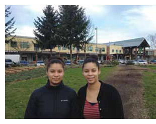 Cherise and Dennise Mofidi stand outside the Portland, Oregon restaurant where they were sexually harassed.