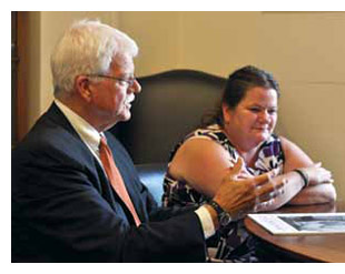 Congressman George Miller talks with Betty Harrah in his Washington, DC office. Harrah's brother Steve was killed at the Upper Big Branch coal mine.