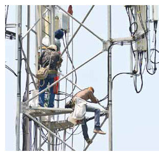 Workers on a cell-phone tower