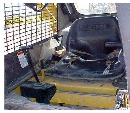Photo of damaged skid steer forklift