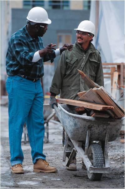men with hard hats talking