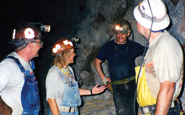 picture of miners talking