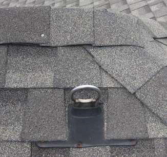 Photo of a roof with an anchor.