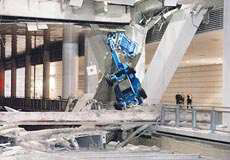 photo showing a structural collapse under the weight of machines