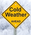 cold weather ahead warning road sign