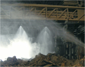 This is a picture of water spraying down an invironment that has silica dust