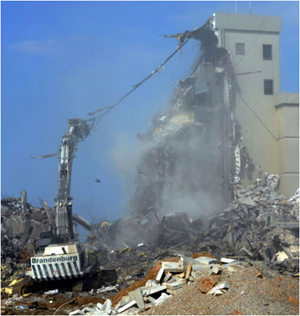Brandenburg Industrial Services Co using a water sprayer in a high-demolition area