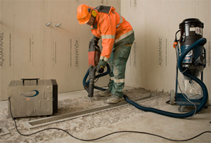 This is a picture of a worker using a hand-held transportable vacuum system