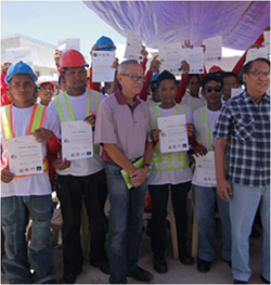 This is a picture of a group of construction workers who have earned a certificate from a training