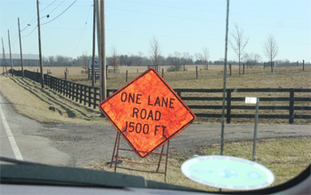 This is a picture of road signage near the accident that reads: One Lane Road 1500 FT