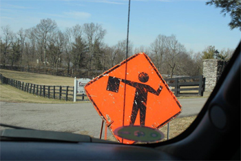 This is a photo of a flagger warning sign on the road