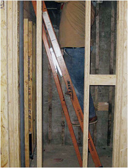 man standing on a rung while the ladder is closed