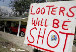 Looters will be shot sign in front of house